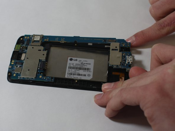 Remove the motherboard from the display screen by lifting it out of place.