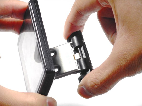 Image 1/3: Remove the plastic connector from the LCD screen arm.