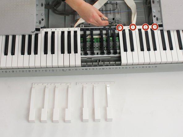 Image 1/2: Remove screws using Phillips #1 screwdriver
