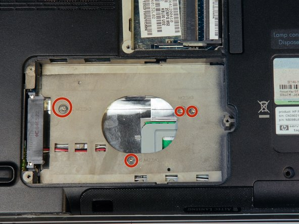 Locate and remove the 4 silver screws beneath where the hard drive was located. They have a 3.5 mm diameter head and will be 3mm in length.