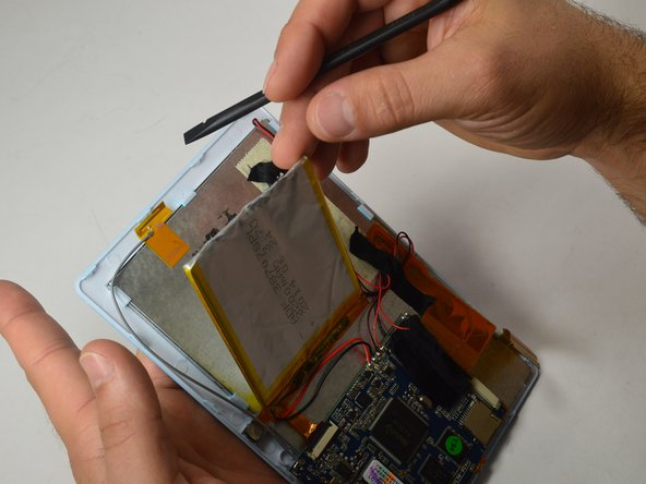 Image 2/3: Note: This will require a little extra force due to the tape holding down the battery!