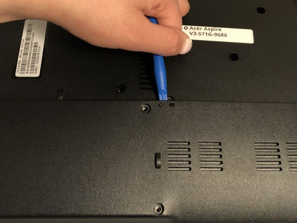 Remove the two screws shown on diagram using a Phillips #00 screwdriver