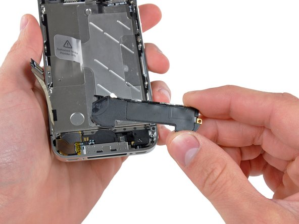 Remove the speaker enclosure from the iPhone.