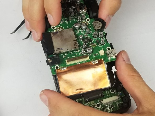 Gently lift the motherboard from the base of the device and set aside.