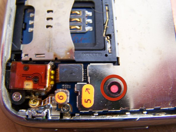 Residue and corrosion discoloration can clearly be seen on the connectors for the LCD, Digitizer, and proximity sensor, as well as the camera and SIM card slot.