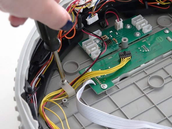Image 1/2: When aligned, install the screw on the hook. Then, attach the thick yellow wire to the lower edge of the circuit board.