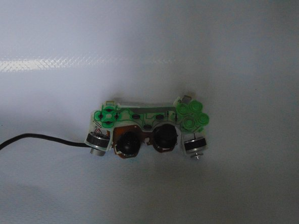 When I lifted the controller out of the chassis one of the dual shock motors fell off it soldering. I removed the other one.