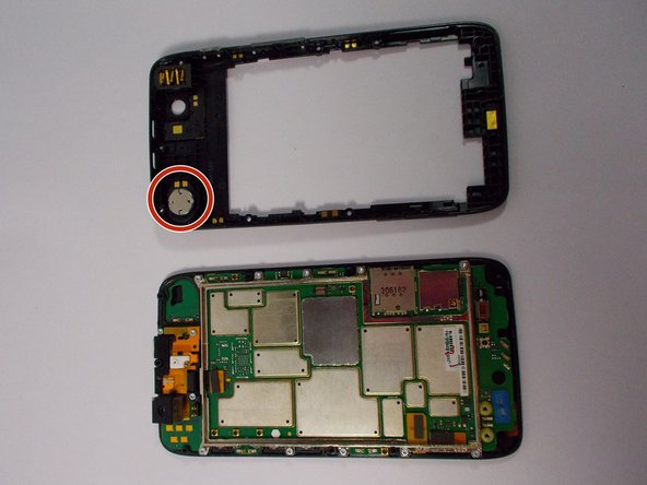 The speaker is located in the upper corner of the case. It it attached with adhesive and can be removed by gently prying with the plastic opening tool