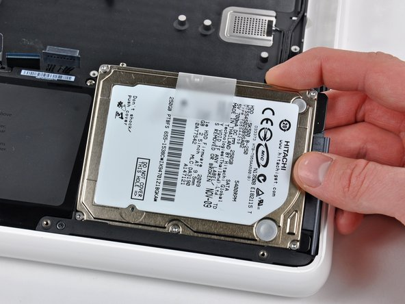 Image 1/1: The hard drive is still attached to the upper case by the hard drive cable.