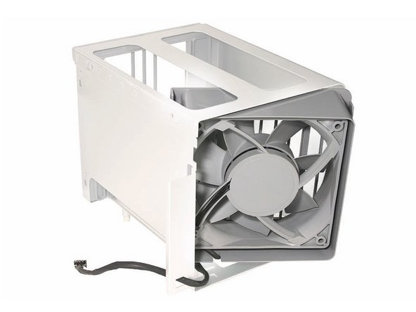 Replacement Note: If you are installing a new fan in the memory cage assembly, rotate the fan into the cage as illustrated. Also note carefully the orientaton of the fan in relation to the cage.