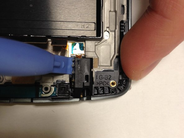 The headphone port is kept in place with an adhesive, so it may take some time and effort to get it out