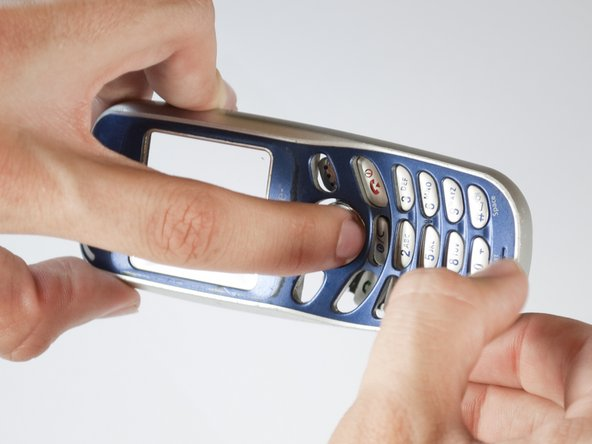 Take out the key pad by pressing the keys on the face of the phone and pulling the rubber keypad from the other side.