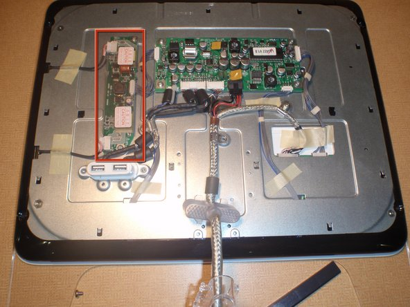 Image 1/1: Look for the smaller of the two circuit boards with two wires and a ribbon cable running out of it.