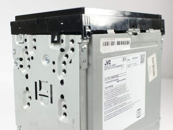 Using your fingers and/or a metal spudger, gently release the plastic locking tabs of the front panel assembly from the steel enclosure while prying the front panel assembly away from the steel enclosure with your fingers.