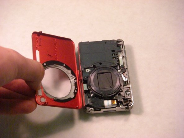 Fully remove the front casing from the camera.