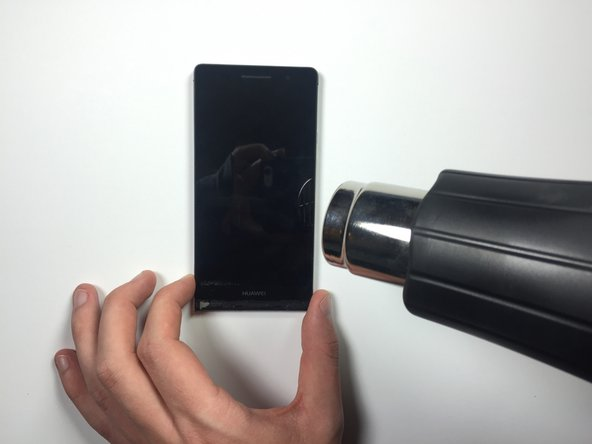 Image 1/1: Start with the heat gun far away from your hand. Then, slowly move your hand towards the heat gun until the air is warm, but not hot.