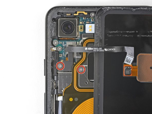 Remove the two 4.1 mm long Phillips screws securing the fingerprint connector bracket.
