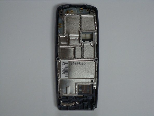 Image 1/3: Pry off the portion of the sticker that is attached to the phone's case. Do not worry about removing the sticker from the metallic plate.
