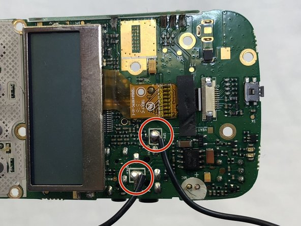 Apply a soldering iron to the solder joints to remove the two wires connecting the speaker to the circuit board.
