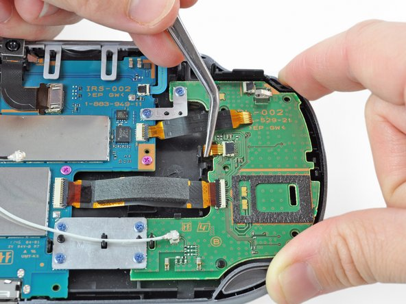 Using tweezers, gently remove the small flex cable from the socket, and rest it out of the way.