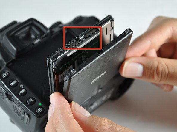 The locking tab and its spring (at the top of the screen; marked in red) are loose and may fall out. Keep the screen horizontal when removing the cover.