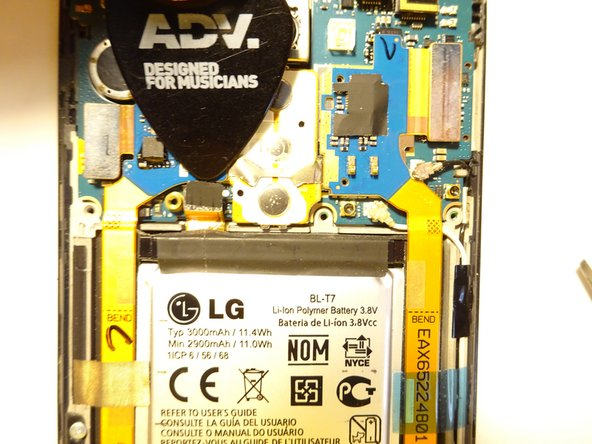 The motherboard will hinge up along the black horizontal bar as seen in the photo. You do not need to fully disassemble the motherboard, flex cables, etc. per other guides.