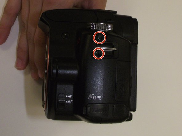 Remove two screws from the left hand side of the camera.