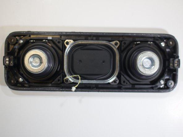 Remove the two silver screws on each speaker shield using the  screwdriver with the PH1 head.