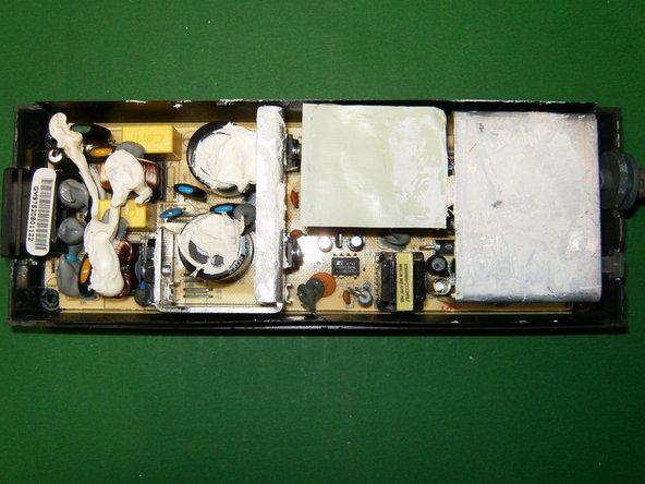 Here is the circuit board still in the bottom case.