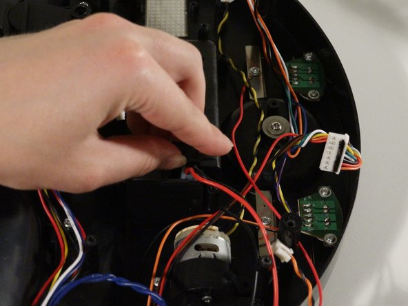 Pull the wire out of the compartment to detach the power switch and its wires from bObsweep.