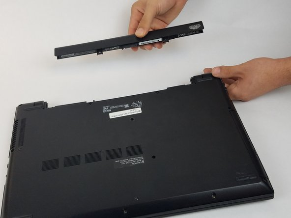 Pull the battery out, keeping it flat and parallel to the laptop so that it slides out easily.