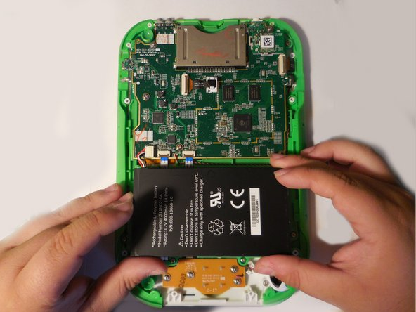 Take off the hard plastic casing, exposing the motherboard and battery.