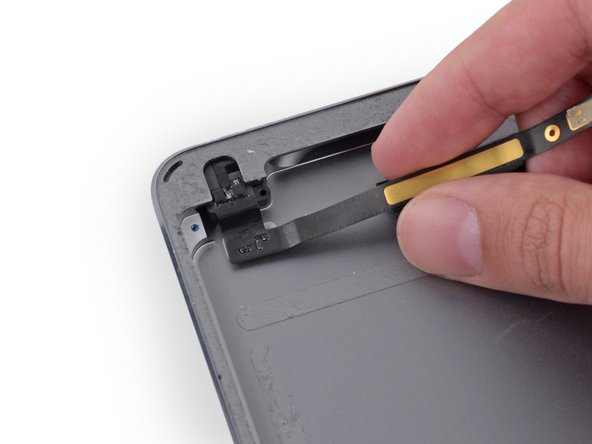 Use the headphone jack cable to gently remove the headphone jack from its recess in the case.