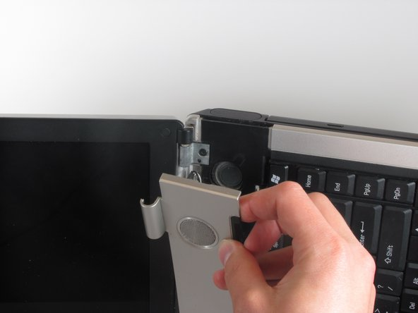 Image 2/2: Once the top part of the laptop's case has been popped off, use your hands to remove it.