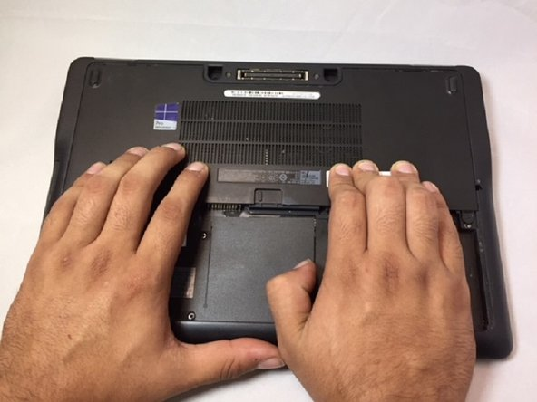 Placing your hands on either side of the panel, push down and pull back to slide the plate back and off.