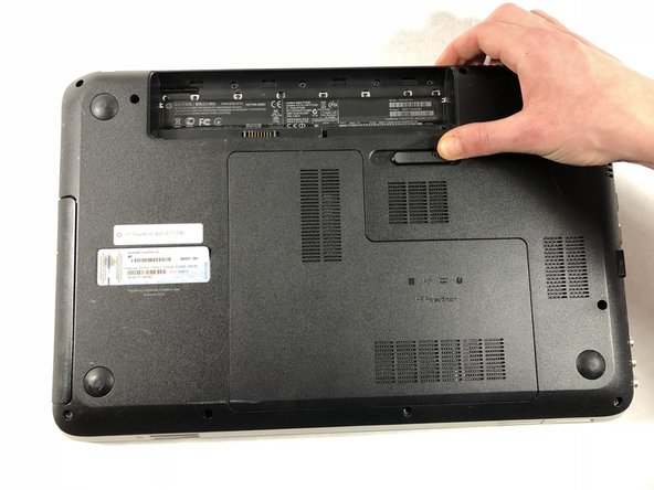Begin removing the bottom cover by sliding the battery removal slider to the right to pop off the top of the cover.