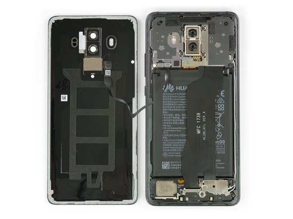 Behold, the wonderful inner workings of Huawei's new flagship! The first thing to catch our eye is a huge flex cable running from the daughterboard up to the main board, where all the exciting chips live.
