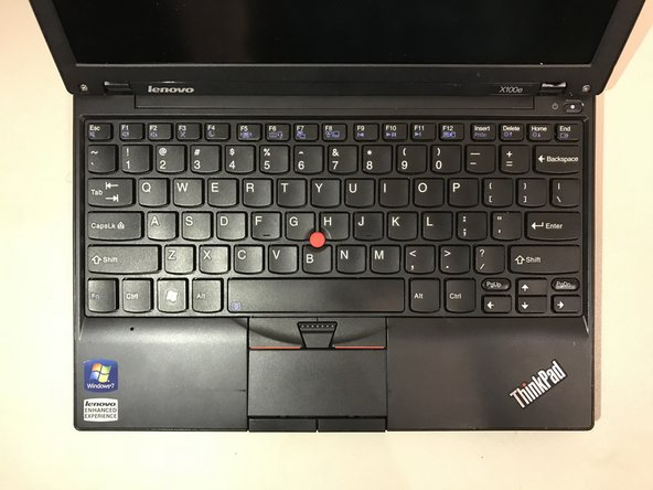 Remove battery by flipping the laptop over and pressing the two tabs inward and place aside