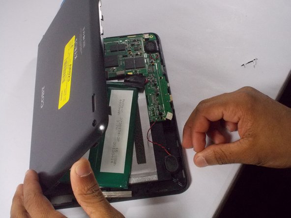 Image 3/3: Once the edges are wedged apart, use hands to lift up the back of the tablet.