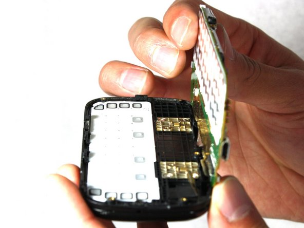 Pull the motherboard away from the rest of the phone.