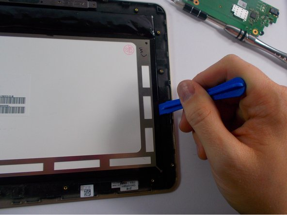 Use plastic opening tool to pry display screen from front panel.