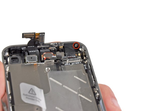 Remove the 1.5 mm Phillips screw securing the front panel near the headphone jack.