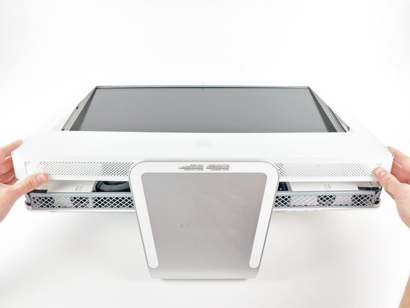 Image 1/3: The third picture shows the top front bezel brackets and their slots cut into the top edge of the iMac's rear case.