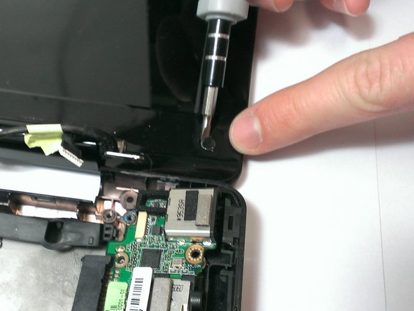 Image 1/2: Using the Phillips #00 screwdriver, unscrew the two 2mm and four 4mm screws from underneath the chits.
