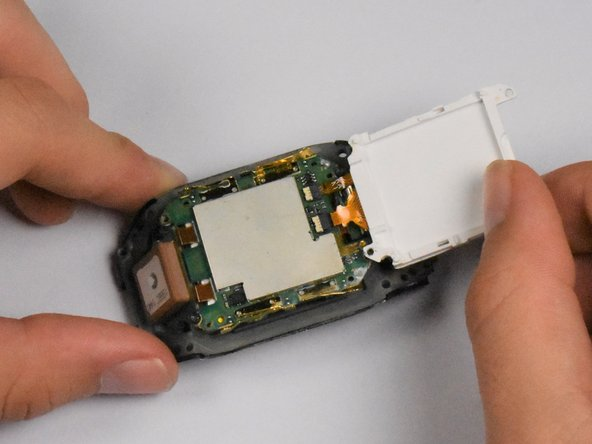 Lift the display from the board from the top side of the watch, revealing the display connectors underneath.