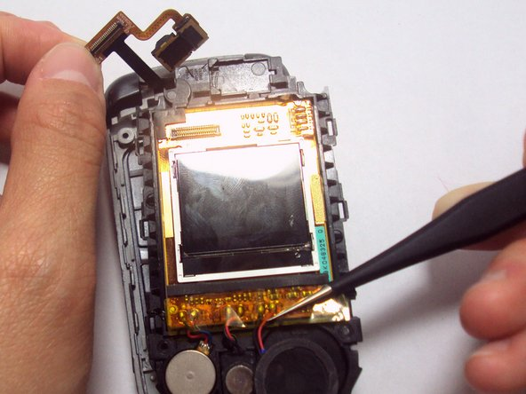 Use your fingers to lift up the detached flex cable and use the tweezers to lift the LCD screen component out of the phone casing.