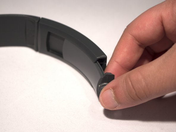 Using a little amount of force, slide the plastic cover off of the headband.