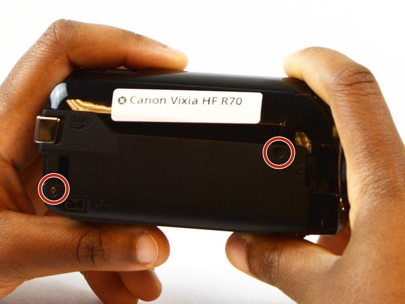 Position the camcorder so that the side panel is facing you.