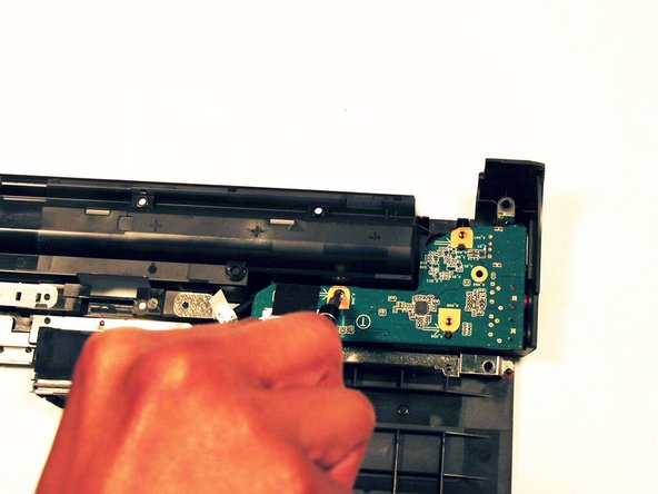 Remove the screws holding the headphone jack board down.