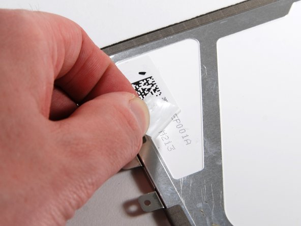 Image 1/2: Peel back the sticker, and more part numbers can be seen near the bottom of the LCD.